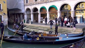 Venice, Italy - 14.03.2019: gondola with tourists in the narrow canals of Venice.  stock video
