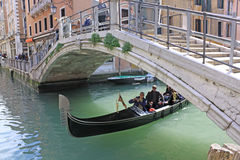 Venice, Italy. Gondola under the bridge. The gondola is a traditional, flat-bottomed Venetian rowing boat, well suited to the conditions of the Venetian lagoon Stock Photo