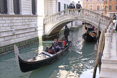 Venice, Italy. Gondola under the bridge. The gondola is a traditional, flat-bottomed Venetian rowing boat, well suited to the conditions of the Venetian lagoon Royalty Free Stock Image