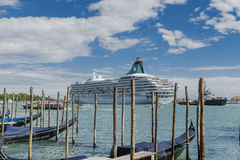 Venice in Italy , Gondolas with big ship in background Royalty Free Stock Photography