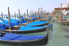 Venice, Italy. Gondolas. The gondola is a traditional, flat-bottomed Venetian rowing boat, well suited to the conditions of the Venetian lagoon. The rowing oar Stock Photos