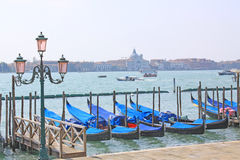 Venice, Italy. Gondolas. The gondola is a traditional, flat-bottomed Venetian rowing boat, well suited to the conditions of the Venetian lagoon. The rowing oar Royalty Free Stock Images