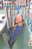 Venice, Italy. Gondolas. The gondola is a traditional, flat-bottomed Venetian rowing boat, well suited to the conditions of the Venetian lagoon. The rowing oar Royalty Free Stock Photo