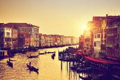 Venice, Italy. Gondolas on Grand Canal at gold sunset. Venice, Italy. Gondolas on Grand Canal, Italian Canal Grande at gold sunset. View from Rialto Bridge Stock Image