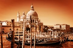Venice, Italy. Gondolas on Grand Canal and the Salute basilica Stock Photo