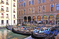 Venice, Italy. Gondolas near hotel. The gondola is a traditional, flat-bottomed Venetian rowing boat, well suited to the conditions of the Venetian lagoon. The Royalty Free Stock Image