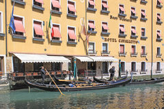 Venice, Italy. Gondolas near hotel. The gondola is a traditional, flat-bottomed Venetian rowing boat, well suited to the conditions of the Venetian lagoon. The Royalty Free Stock Photos
