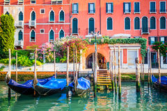 Venice, Italy - gondolas at pier on water canal Royalty Free Stock Images