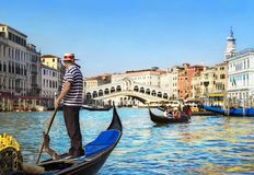Venice, Italy. Gondolier with rowing oar in his gondola on Grand royalty free stock images