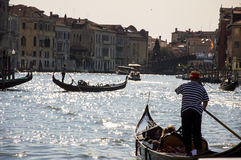 Venice,Italy. Venice,Grand canal,gondolier in the evening shift royalty free stock image