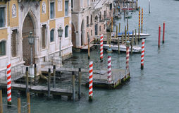 Venice, Italy and Grand canal with its pears and docks with boats Royalty Free Stock Images