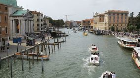 Venice Italy Grand Canal Transport Routes, view from the Bridge. VENICE, ITALY, SEPTEMBER 7, 2017: Venice Italy Grand Canal Transport Routes, view from the stock footage