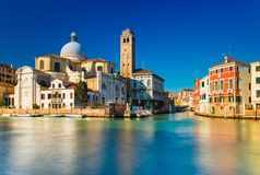 Venice, Italy: Grand Canal and Venetian old architecture against the clear blue sky on the background. Venice, Italy. Grand Canal and Venetian old architecture Stock Images