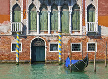 Venice, Italy - House on Grand Canal with gondola Royalty Free Stock Photo