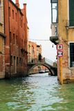 Venice, Italy. House, home, apartment, tourist, tourism, outdoors, window, water, canal, gate, brick, balcony, flower box, Sky, shutters, wood, building Royalty Free Stock Images
