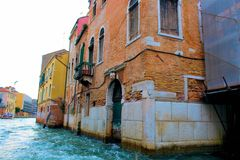 Venice, Italy. House, home, boat, old, architecture, shutters, Windows, ancient, water, Canal, city, old city, wood, plants, balcony, iron, chimney, lights Stock Photo