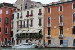 Venice, Italy. House, home, boat, old, architecture, shutters, Windows, ancient, water, Canal, city, old city, wood, plants, balcony, iron, chimney, lights Stock Photos