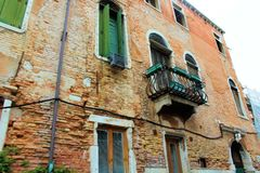Venice, Italy. House, home, boat, old, architecture, shutters, Windows, ancient, water, Canal, city, old city, wood, plants, balcony, iron, chimney, lights Royalty Free Stock Photos