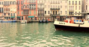 VENICE, ITALY - January 2014: A boat enters frame on grande canal stock video footage