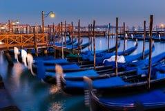 Venice. ITALY. January 11, 2006. Gondolas at dusk bobbing in the canal Royalty Free Stock Photography