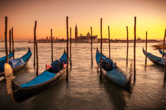 Venice. ITALY. January 11, 2006. Gondolas at dusk bobbing in the canal with San Giorgio Magiore in the background Royalty Free Stock Photos