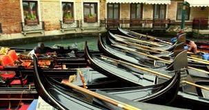 VENICE, ITALY - January 2014: Gondolas on water Royalty Free Stock Image
