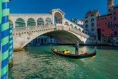 Venice. ITALY. January 2006. Gondolier passes under Rialto bridge Stock Photos