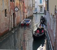 Gondoliere driving red gondola in Venice, Italy royalty free stock images