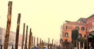 VENICE, ITALY - January 2014: Lots of gondolas on grande canale stock video footage