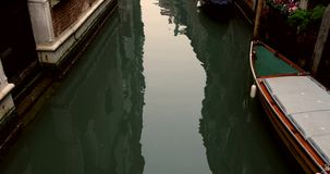 VENICE, ITALY - January 2014: Tilt with empty canals and old buidings stock video