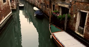 VENICE, ITALY - January 2014: Tilt with empty canals and old buidings stock video footage