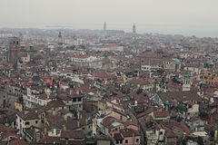 VENICE, ITALY. JANUARY 05, 2016 - View of the city from the bell tower of the Cathedral of St. Mark. The city gradually enveloping Royalty Free Stock Photography