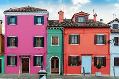 Colorful houses in Burano island. VENICE, ITALY - JANUARY 06, 2018: View on the colorful houses in Burano island, during winter days, Venice, Italy Royalty Free Stock Photo