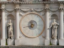 Clock in Doge`s Palace. Venice,Italy-July 25, 2018: Ancient clock in Doge`s Palace or Palazzo Ducale, Venice stock photography