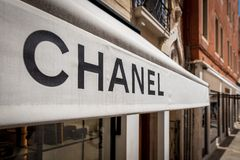 Venice, Italy - July 4, 2018: Chanel brand sign at store front. It is a high fashion house that specializes in luxury stock photography