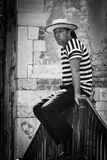Gongolier man in Venice, photo in black & white. stock images