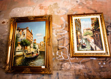 Venice, Italy - JULY 25, 2016: Picture exhibition on an old building wall.Art on the street. Picture exhibition on an old building wall.Art on the street stock photo