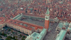 Venice, Italy - June, 2019: Aerial drone panorama view of Venice beautiful architecture. Flight over canals and roofs.