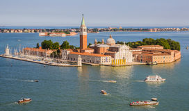 Venice, Italy - June 27, 2014: Bird's eye view from St. Mark's Campanile on church of San Giorgio Maggiore situated on island Stock Photography