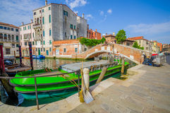VENICE, ITALY - JUNE 18, 2015: Boats are the main transporation way on Venice, bridges in the middle for pederestians Royalty Free Stock Image