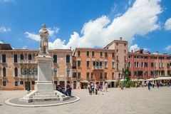 VENICE, ITALY - JUNE 15, 2016: View of statue of Nicolo Tommaseo on St. Stephen`s square campo Santo Stefano royalty free stock photo