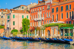 Venice, Italy - June 28, 2014: Cityscape of Venice - gondolas moored on water canal Royalty Free Stock Image