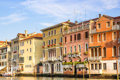 Venice, Italy - June 28, 2014: Cityscape of Venice - view on colorful buildings built directly on water canal Royalty Free Stock Image