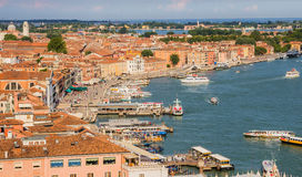 Venice, Italy - June 27, 2014: Cityscape of Venice - view from St. Mark's Campanile on quay and water buses moving on Grand Canal Stock Image
