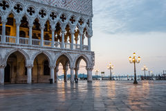 Venice, Italy - June 28, 2014: Cityscape of Venice - view from St. Mark's square on Doge's Palace and Grand Canal early in the mor Royalty Free Stock Photography