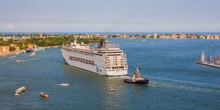 Venice, Italy - June 27, 2014: Cruise liner sailing on Grand Canal in Venice Royalty Free Stock Photo