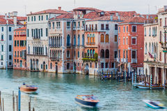 Venice, Italy - June 27, 2014: Evening view on colorful residential houses built directly on Grand Canal. View from Rialto bridge. Royalty Free Stock Photos