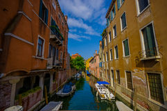 VENICE, ITALY - JUNE 18, 2015: Famous Venice canals, romantic photos of parking boats in the middle of houses Royalty Free Stock Image