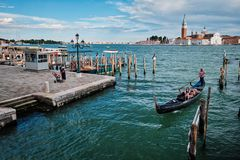 Gondolas and in lagoon of Venice by Saint Mark San Marco square stock photo