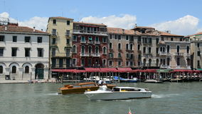 VENICE, ITALY - JUNE 16: The motor boats with tourists are on Grand Canal on June 16, 2014 in Venice, Italy. More then 46 mln tourists is expected to visit stock footage